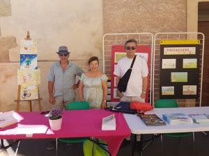 Jacques Chamayou, Michel Roman et Monique-Marie Ihry présentant leurs ouvrages de littérature jeunesse
